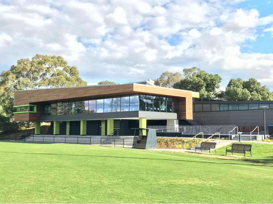 Dunlop pavillion building next to oval with seating
